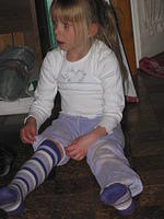 Carrie putting back on her knee socks.